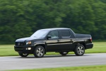 2013 Honda Ridgeline in Crystal Black Pearl - Driving Front Left Three-quarter View